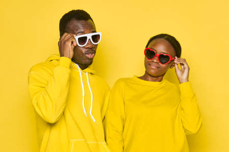 Man and woman african appearance yellow isolated background communication Standard-Bild