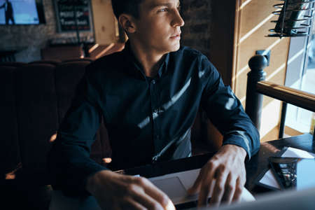 Business man freelancer working in a cafe laptops communication phone room manager model