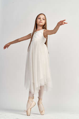 Girl ballerina in a light suit in full growth pointe shoes model dance Stockfoto