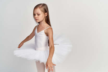 Girl ballerina dance performed training white tutu