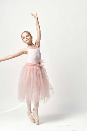 Girl ballerina in pink dance costume ballet dance pointe shoes tutu light background model Stockfoto
