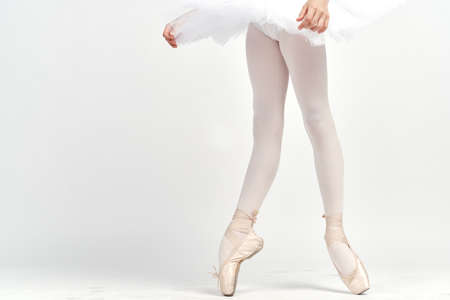 pointe shoes ballerina tutu dance child light background cropped view