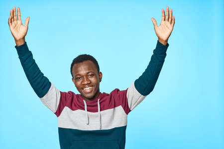 A happy African-looking man in a warm sweater