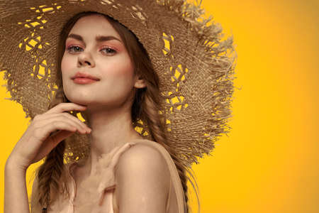 Lady in a hat and dress red hair yellow background model portrait fun Banco de Imagens