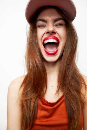 Beautiful woman in a cap Eyes closed model mouth open red lips Reklamní fotografie