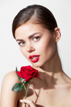 Woman with red flower Bare shoulders pure luxury leather red lips