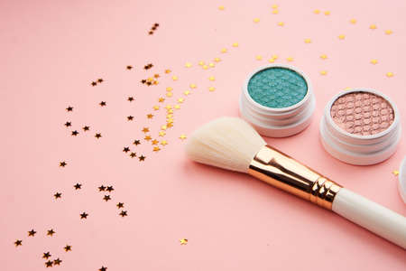 eyeshadow makeup brushes collection professional cosmetics accessories on pink background