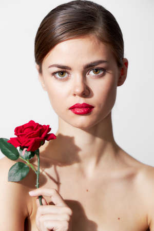 Woman with flower Bare shoulders are an attractive luxury look red lips