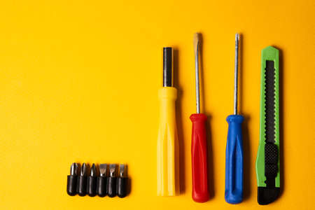 screwdrivers and construction tools on yellow background equipment for repair industry