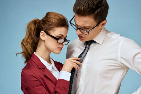 Business young couple officials office team office blue background
