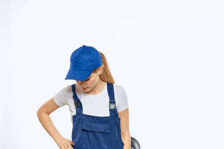 Woman in working uniform blue cap delivery courier delivery service