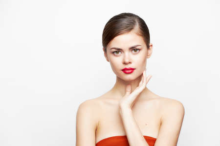 Woman with bare shoulders Look forward red lips charm