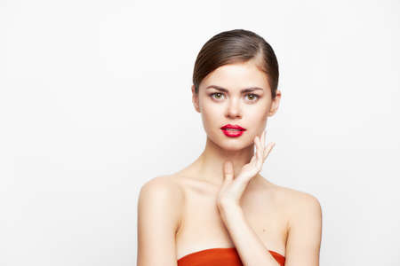 woman with bare shoulders Attractive look red lips body care