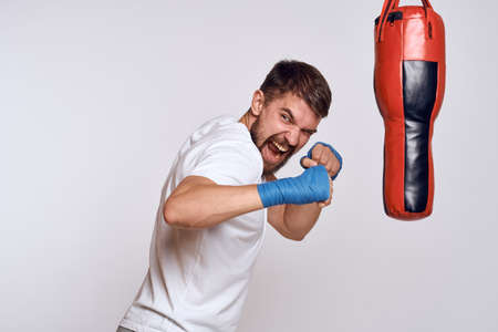 Sports car punching bag bandages on the hands of the exercise