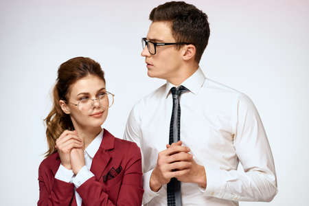 man and woman work colleagues officials communication light background