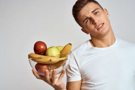 Man with fresh fruit in a cup health lifestyle healthy nutrition vitamins