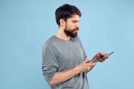 Man with tablet in hands technology lifestyle wireless device blue background