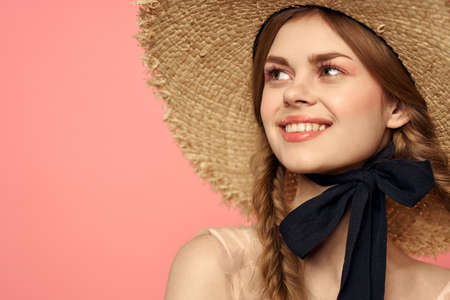Romantic girl with pigtails and in a straw hat smile romance pink background Copy Space