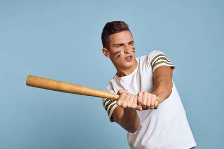 baseball guy with a bat in his hand on a blue background and a combat color on his face makeup model t-shirt