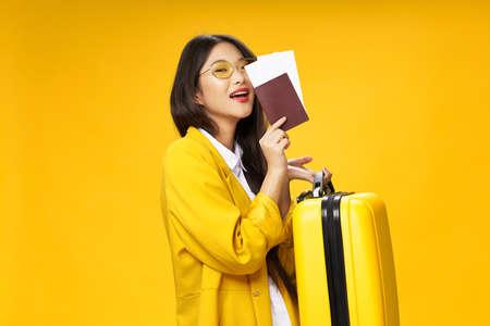 Woman tourists passports plane tickets suitcase passenger airport