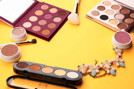 Professional cosmetics palette with eyeshadow makeup brushes cropped look