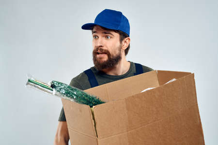 Male worker loading delivery boxes in hands packing lifestyle