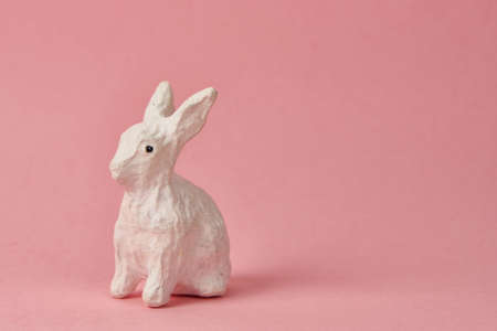 Easter bunny on a pink background toy animal holidays