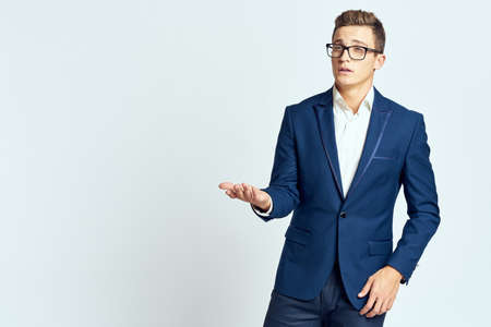 Business man wearing glasses blue suit cropped view official light background