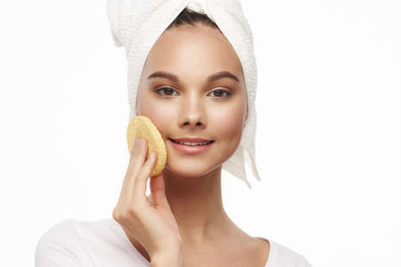 Clean skin of the face soft sponge charming girl with a towel