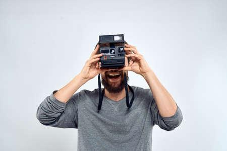 photographer with camera hobby technology studio lifestyle creative light background Stockfoto