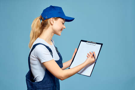 Woman in working form paperwork rendering services career office blue background. High quality photo