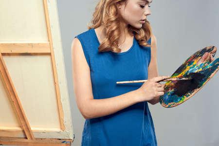 Woman artist blue beret drawing palette easel art hobby Creative