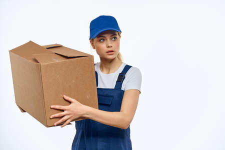 Woman working uniform box in hands packing service light background