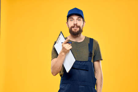 Man in working form documents transportation delivery service yellow background