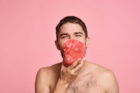 bearded man with bare shoulders with a washcloth clean skin bathroom Stockfoto