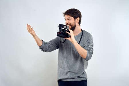 Male photographer professional camera work Studio Technology modern art light background Stockfoto