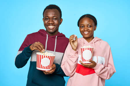 Popcorn watching movies in the cinema African looking man woman
