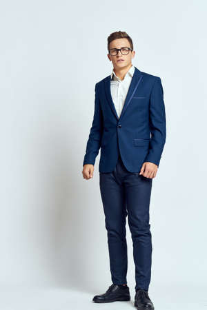 business man in suit wearing glasses self-confidence manager executive light background Archivio Fotografico