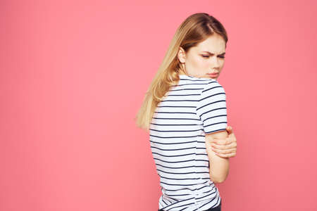 Woman in striped t-shirt emotions studio cropped view lifestyle pink isolated background Archivio Fotografico