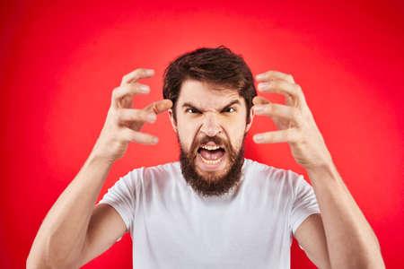 man in t-shirt gesturing with his hands dissatisfaction studio red uniform