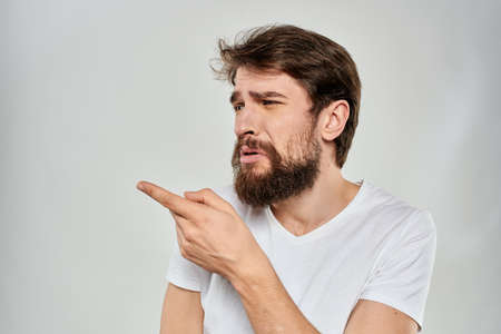 Bearded man gesturing with hand white cropped t-shirt studio lifestyle