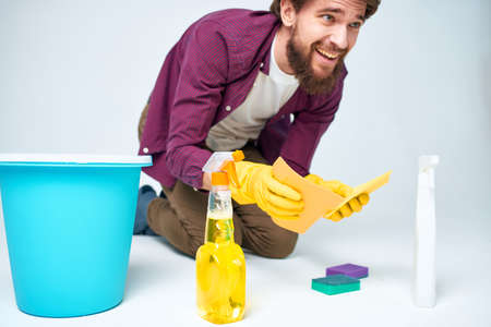 man wearing rubber gloves cleaning interior service professional