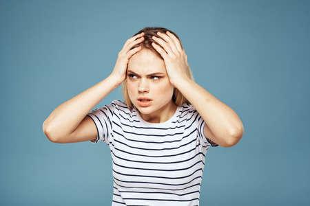 Upset woman emotions displeasure gestures with hands blue background