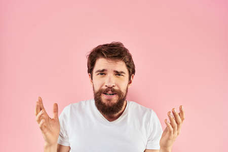 Bearded man white t-shirt cropped view lifestyle studio pink background