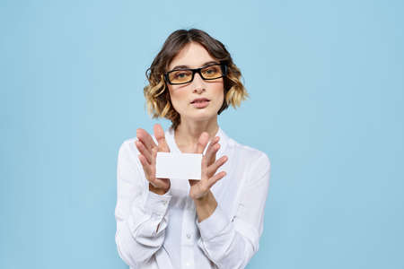 Woman wearing business card glasses in hands on blue background Copy Space cropped view 版權商用圖片