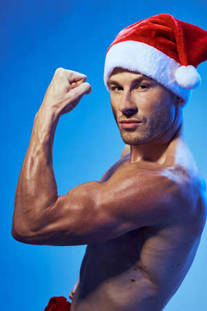 bodybuilder christmas new year man with muscular Stock Photo