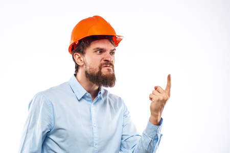 Angry man in orange hard hat industry work dissatisfaction cropped view