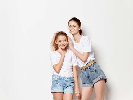 Mom and daughter hugs family fun White t-shirts studio Archivio Fotografico