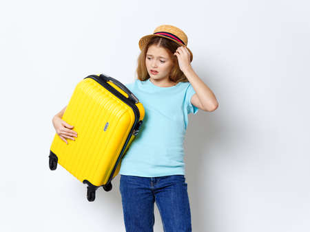 Girl with yellow suitcase vacation travel passenger studio