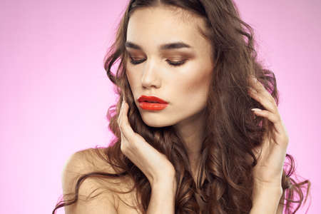 Woman with hairstyle and red lips shoulders bright makeup attractive look